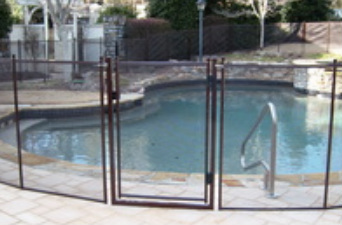 Pool safety gate installed in a paver pool deck, bronze color pool fence in Tampa