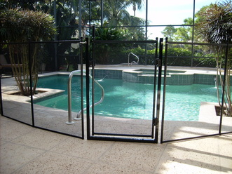 A pool safety fence with gate in Tampa FL www.tampapoolfence.com